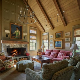 Chic farmhouse vaulted family room with wooden ceiling and walls