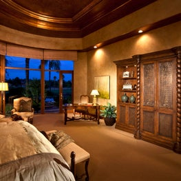Warm, rich master bedroom with custom cabinetry, faux finish walls & ceiling