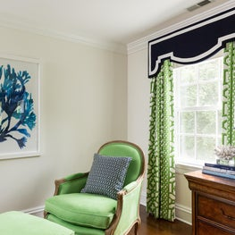 Bold  blue wall art creates a focal point for this transitional bedroom design.