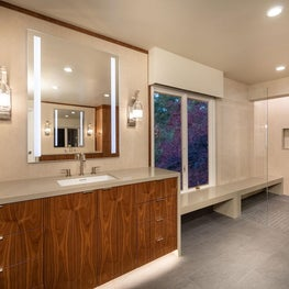 Open Plan Fusion - Walnut vanity, Caesarstone countertop, glass open shower with long bench, and grey tile flooring