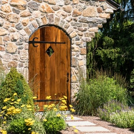 Wooden gate to English gardens for new home in Greenville, Delaware