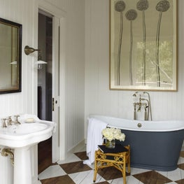 Bathroom with freestanding tub, checkered wood floors