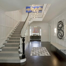 Stair hall with paneled walls