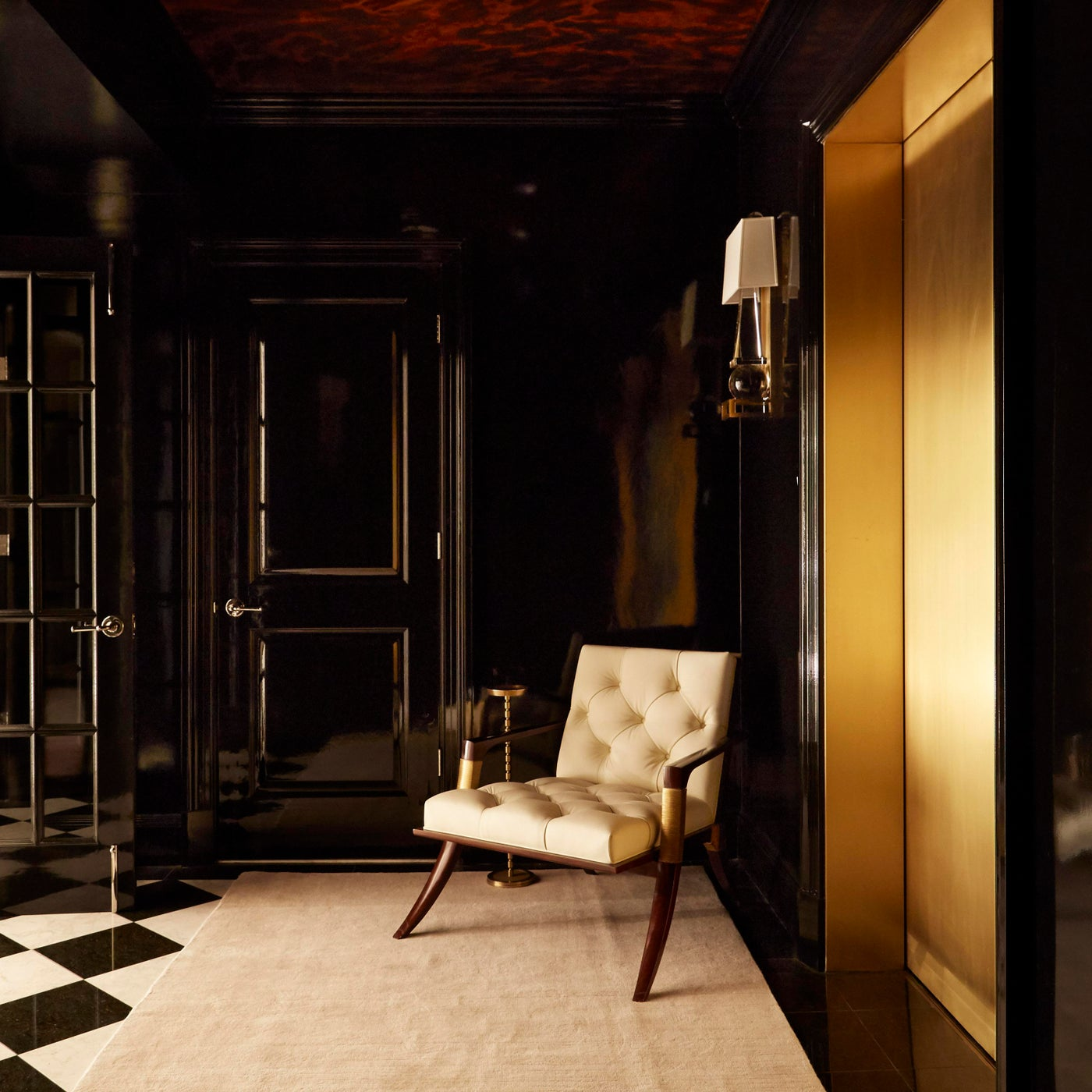 Brass elevators open directly into the private foyer.