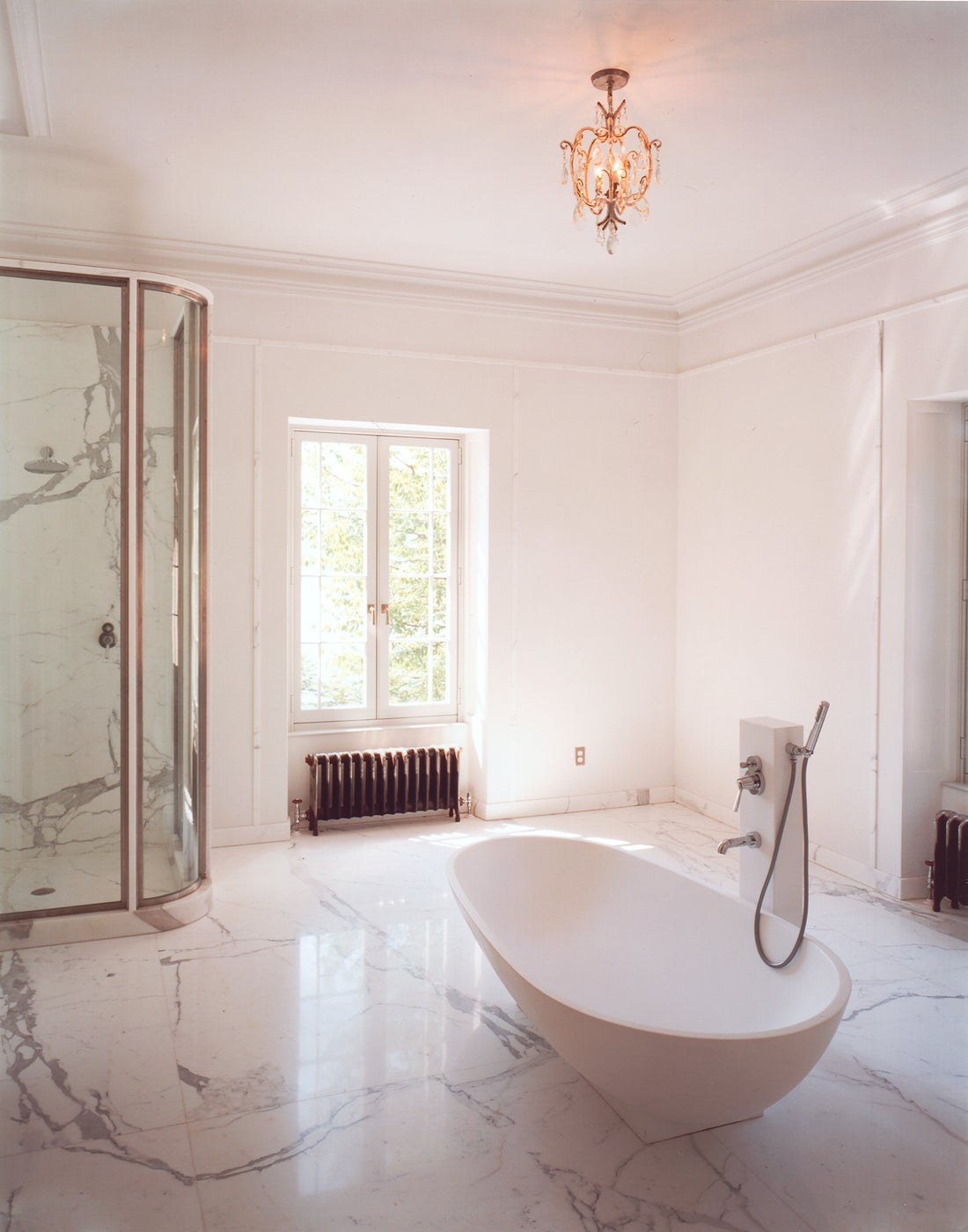 A marble bathroom in the renovation of a historic Hudson River home