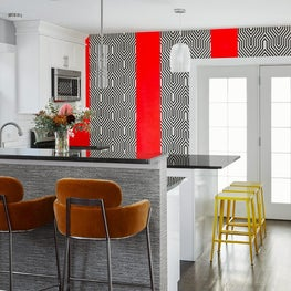 Mix of paint and  black and white wallpaper.  Makes a colorful kitchen design