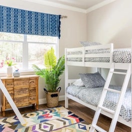 Kids room with colorful rug and window valance