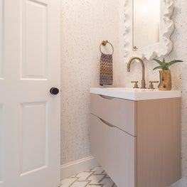 Luxe Powder Room with Brass and White finishes