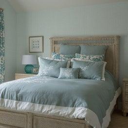 Blue bedroom with coastal motifs