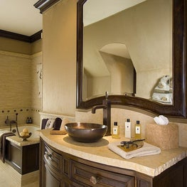 This young man's bathroom is finished with chiseled stone, supple suede, and ancient fossil details.