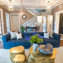 Living room with blue sofa and gold coffee table