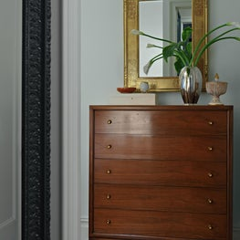 This master bedroom features a stunning Mercury vase by Carlos de la Puente Antiques and gold leaf mirror by APF Master Frame Makers