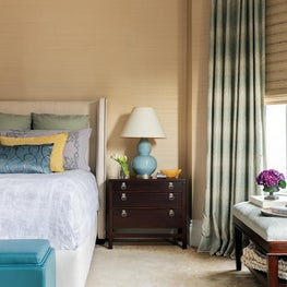 Textured wallpaper & ceiling in cozy bedroom featuring a calming color palate