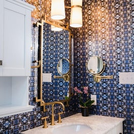 Brass Faucet and Geometric Wallpaper in this Glamorous Bathroom