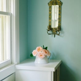 Historic House on the Hill, Boulder Colorado - Dining Room vignette with with pale pink roses and brass mirror