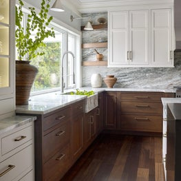 Contemporary Farmhouse Kitchen with White & Walnut Cabinetry and Natural Stone Slab