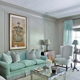 Mint color palette, mirrored coffee table, and old-world influences