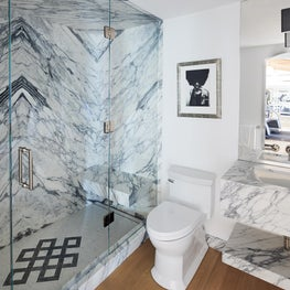 Dramatic book matched marble bathroom