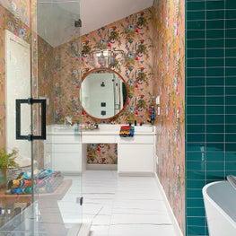Whimsical wallpaper in main bathroom
