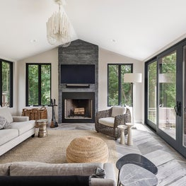 Textures and organic elements work with the natural light in this Sunroom.