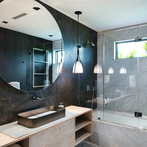 Various marbles and stone were used throughout this bathroom, from walls to countertop insets.