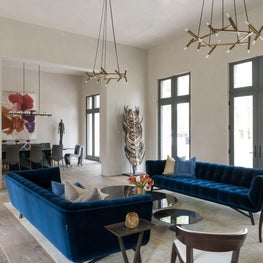 Modern colorful living room + blue velvet seating & Jonathan Browning fixtures