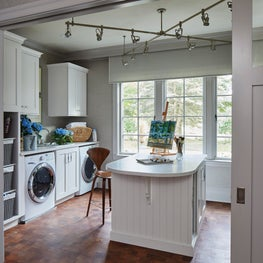 Wood and white Art & Laundry Studio, walnut Cherner stool, waxed mesquite floor