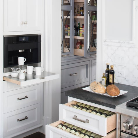 Custom white cabinetry provides abundant storage in this contemporary kitchen.