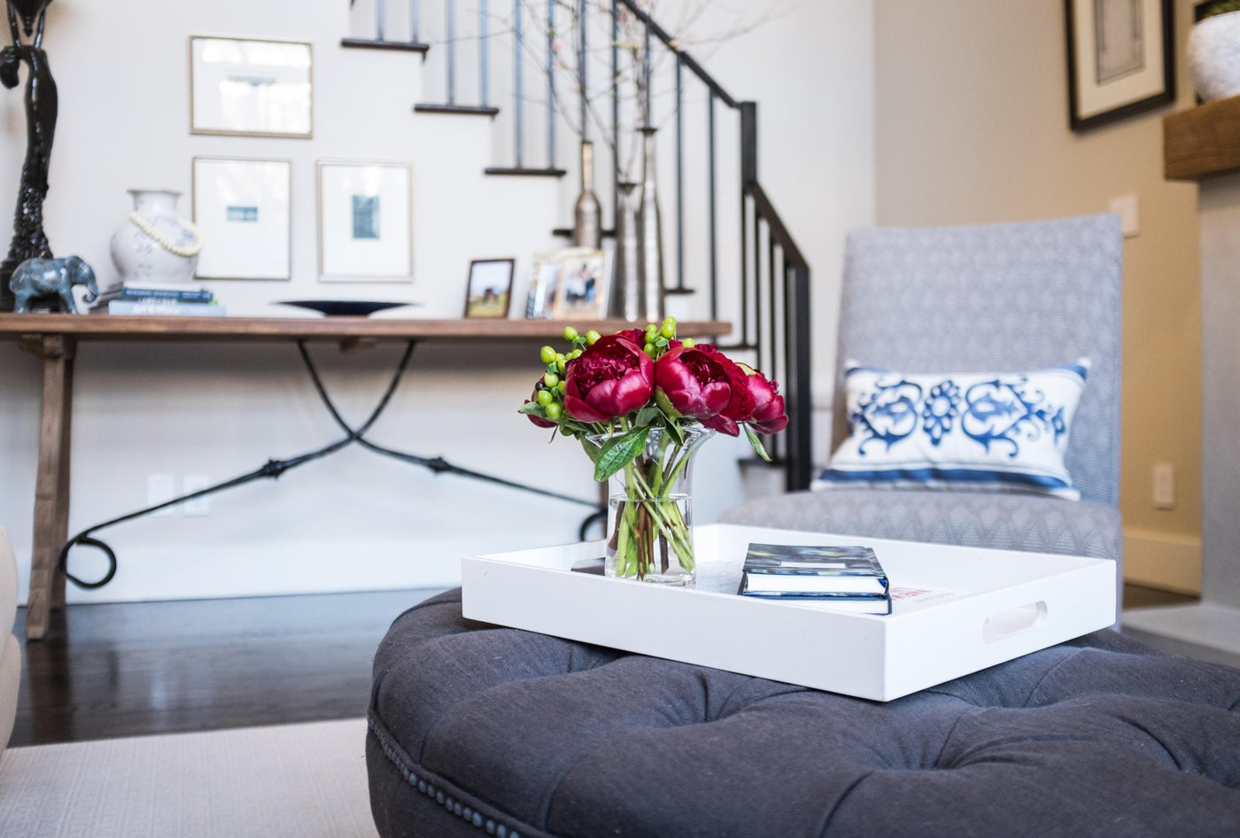 Living Room Ottoman with modern lacquer tray topped with peonies