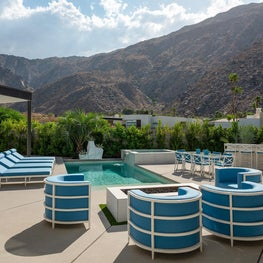 Modern Pool with White and Aqua Blue Patio Furniture