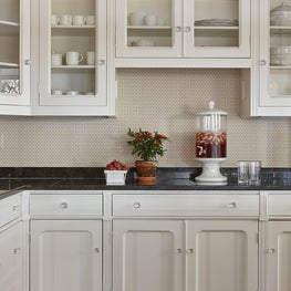 Beach house Kitchen cabinet detail. Painted cabinets with glass hardware.