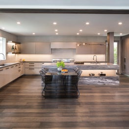 Modern Bel Air open kitchen. Gloss lacquer lower cabinets and matte-back painted glass upper cabinets.