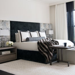 Chic black and white bedroom with glamorous accents