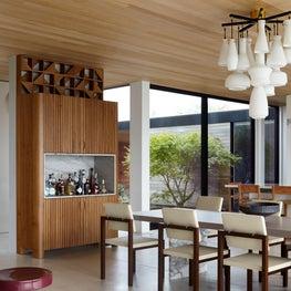 Southampton Beach House, Dining Area Features Custom Wood/Stone Bar