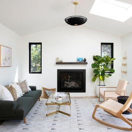 Bright living room with inset fireplace, geometric rug and contemporary seating