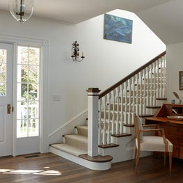 Entry staircase with antiques.