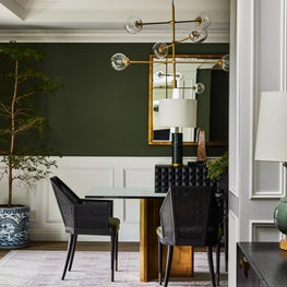 Dining Room View with Earthy Green Walls and Nude Geometric Rug
