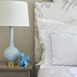Vintage foo dog ceramic and hints of blue in this guest bedroom vignette