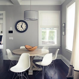 Clean grey kitchen with minimal detail, mid-century chairs