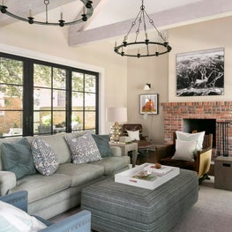 North End Boise family room exposed beams, brick fireplace & large sliding doors