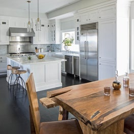 Marble Countertops, White Cabinets, Natual Wood Table, Eat-in Kitchen
