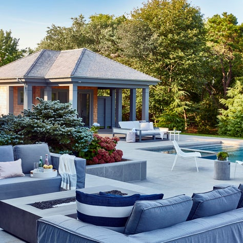 Quogue, Hamptons outdoor - backyard with pool house, pool and outdoor furniture.