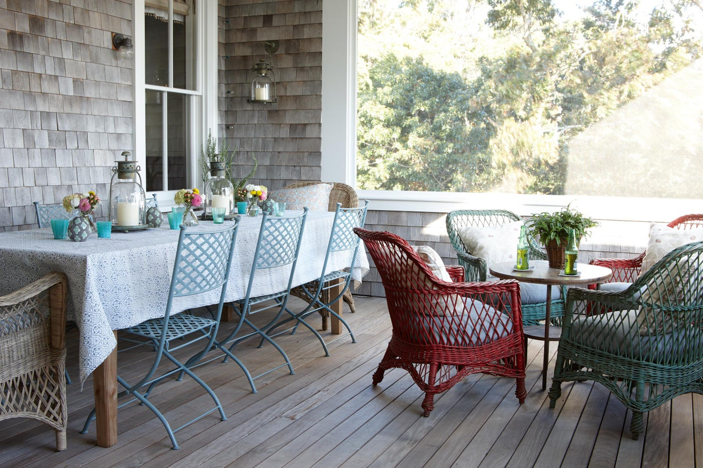 Exterior porch with antique wicker chairs.
