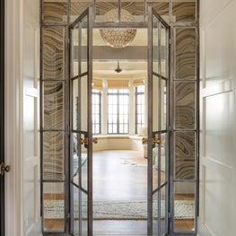 Horse Meadow country house custom steel master bathroom doors and handpainted marble wallpaper.