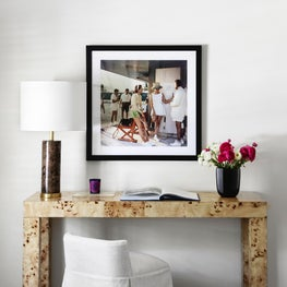 Master bedroom burlwood vanity with Slim Aarons photography art