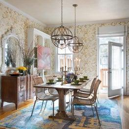 Dining room antique contemporary bright blue rug pendants vine leaf wallpaper