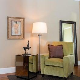 Ralph Lauren inspired bedroom sitting area; leather rug