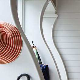 Curve detailing in this mudroom elevates the look from a purely functional space