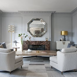 Right Bank Paris living room with custom fireplace, mirror and table by Deniot