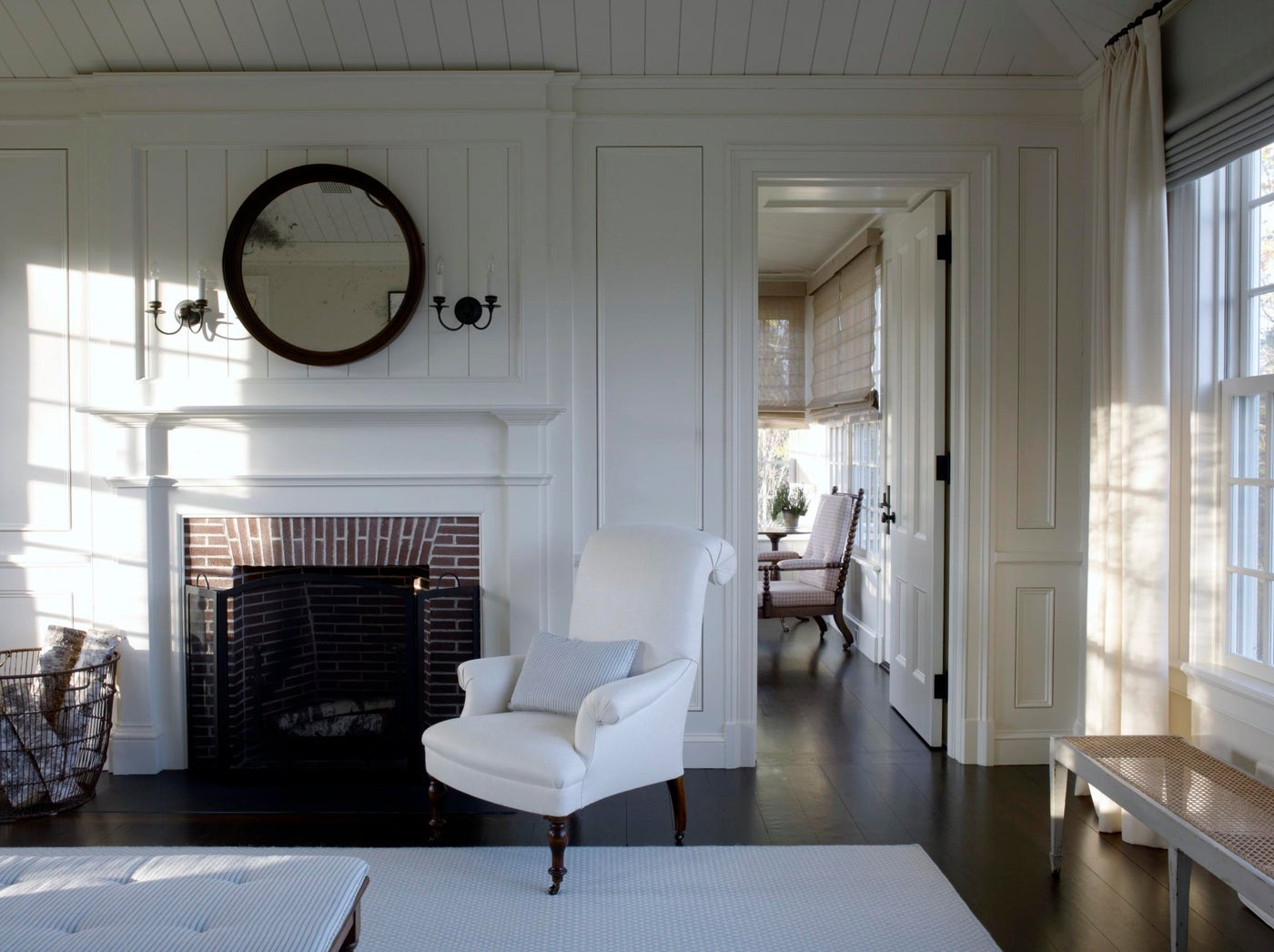 A Master Bedroom fireplace detail with sunroom beyond